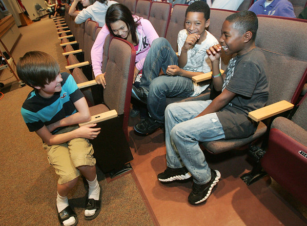 Globe/Roger Nomer<br /> (from left) Grant Landis laughs with Alexus Ward, David White and Jaizon Madison, seventh graders, following the premier of his music video at South Middle School on Tuesday.