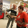 Globe/Roger Nomer<br /> Brian and Elsie Bennett, Liberal, shop for Christmas items at Sears on Monday morning.