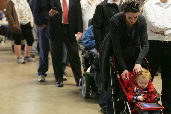 Globe/Roger Nomer<br /> Morgan and Taye, 21 months, Goodfellow, Joplin, wait in line to vote at Royal Heights United Methodist Church on Tuesday.