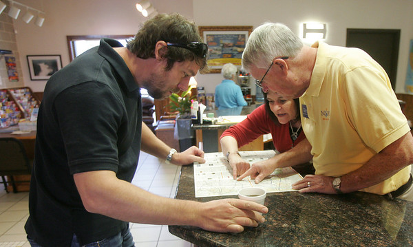 Globe/Roger Nomer<br /> Derek Anderson, Tulsa, gets free coffee and travel advice from Kamala Bramlett and Glen Roark at the I-44 visitors center on Tuesday.