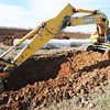 Globe/T. Rob Brown<br /> Bill Etcheson, track hoe operator and co-owner of Etcheson Construction LLC of Diamond and Jasper, digs a ditch for a storm water system under the entryway Tuesday afternoon, Nov. 13, 2012, on the land at the southwest corner of East 32nd Street and Kodiak Road, at the Crossroads Industrial Park.