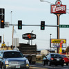 Globe/T. Rob Brown<br /> Motorists drive down South Range Line Road at the intersection with 17th Street, near the rebuilt Academy Sports & Outdoors, Wendy's and Backyard Burgers businesses Tuesday afternoon, Nov. 6, 2012, in Joplin.