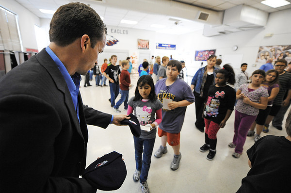 Globe/T. Rob Brown<br /> Attorney Scott Vorhees, partner with Johnson, Vorhees, and Martucci Attorneys at Law, hands out Joplin Eagles stocking caps his firm donated to Joplin School District students Friday afternoon, Nov. 30, 2012, during a stop at Emerson Elementary at Duquesne Elementary School.