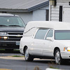 Globe/T. Rob Brown<br /> The hearse and other vehicles start to head toward a graveside service, in Monett, at the beginning of a funeral procession, following funeral services Monday afternoon, Nov. 26, 2012, at McQueen's Funeral Home on W Highway in Wheaton.