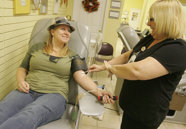 Globe/Roger Nomer<br /> After hearing about a local shortage of O-type blood, Janelle Emery, Neosho, visited the Community Blood Center of the Ozarks to donate as she talks with Karole Long.  The blood center currently is under a yellow warning for O Negative blood.