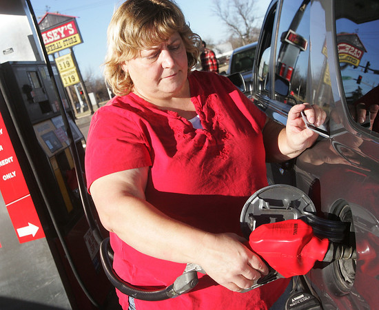 Globe/Roger Nomer<br /> Rita Hecox, Joplin, fills up at the Casey's on Fourth and Maiden Lane on Tuesday afternoon.