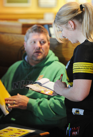 Globe/T. Rob Brown<br /> Buffalo Wild Wings server Ashley Stephens, of Joplin, takes an order from Chris Belk, of rural Joplin, Tuesday afternoon, Nov. 6, 2012.