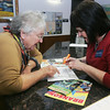 Globe/Roger Nomer<br /> Mary Zembrod, left, Tulsa, gets Branson travel advice from Kamala Bramlett, supervisor at the I-44 visitors center, on Tuesday afternoon.