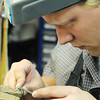 Globe/T. Rob Brown<br /> Adam Grillot, jeweler with Comeau Jewelry's Joplin location, repairs a wedding ring for a customer Thursday afternoon, Nov. 30, 2012.