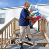 Globe/T. Rob Brown<br /> Flo Taylor, of Joplin, carries an armload of bedding materials from her FEMA mobile home Thursday morning, Nov. 29, 2012, out to her car. Taylor was nearing the final stage of moving out to her own home Thursday.
