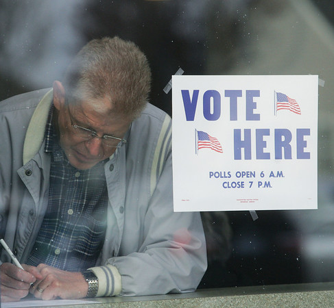 Globe/Roger Nomer<br /> Creed Jones, Joplin, votes by a window at St. Paul's United Methodist Church on Tuesday afternoon.