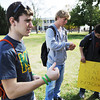 "Globe/T. Rob Brown<br /> Jarrett Epperson, left, a sophomore general business major at MSSU and a member of the Kappa Sigma fraternity, absent-mindedly spints his green ""Beat Pitt State"" arm bands as he and fellow fraternity members look for potential sales Friday afternoon, Nov. 2, 2012, on the campus oval. Kappa Sigma is selling the bracelets to promote the upcoming MSSU-PSU game as well as to make money for a charitable organization. Also pictured are Kyle Heman, center, freshman marketing major, and Dillon Thompson, freshman mass communication major."