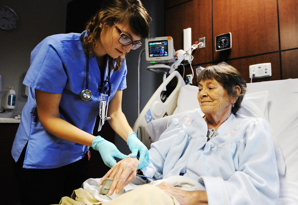 Globe/T. Rob Brown<br /> Freeman Health System nurse Jenna McCarty, R.N., of Pittsburg, Kan., checks the pulse of patient Barbara Turner-Tucker, of Joplin, in her room at Freeman West Thursday afternoon, Nov. 8, 2012.