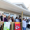 Globe/T. Rob Brown<br /> Scott Clayton, Joplin Area Habitat for Humanity executive director, announces members of five families which will soon be moving into homes built through the Governor's Joplin Challenge in cooperation with Habitat and the Kansas City Chiefs in front of Norma Taylor's home Tuesday afternoon, Nov. 13, 2013, in the 2600 block of Kentucky Avenue. The five families include: Taylor, Wayne and Jamie Crandell, Amy Stockton, Linda Hazley and Laurence and Marchella Claar.