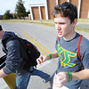 "Globe/T. Rob Brown<br /> Jarrett Epperson, right, a sophomore general business major at MSSU and a member of the Kappa Sigma fraternity, walks across campus to sell green ""Beat Pitt State"" arm bands to students and faculty Friday afternoon, Nov. 2, 2012. Epperson and fellow Kappa Sigma member Dillon Thompson, freshman mass communication major, were selling the bracelets to promote the upcoming MSSU-PSU game as well as to make money for a charitable organization."