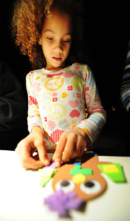 Globe/T. Rob Brown<br /> Eight-year-old Madison Downey, of Joplin, creates a gingerbread girl at the arts and crafts booth Friday night, Nov. 30, 2012, following the lighting of the Christmas tree in Spiva Park.