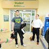 "Globe/T. Rob Brown<br /> Jarrett Epperson, left, a sophomore general business major at MSSU and a member of the Kappa Sigma fraternity, speaks about the progress of sales on green ""Beat Pitt State"" arm bands with (from left) Johnathan Saunders, senior political science major, Ryan Priscock, senior economics major, and Dillon Thompson, freshman mass communication major, Friday afternoon, Nov. 2, 2012, at the Billingsly Student Center. Kappa Sigma is selling the arm bands to promote the upcoming MSSU-PSU game as well as to make money for a charitable organization."