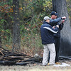 Globe/Roger Nomer<br /> Investigators take photos of plane wreckage west of Stotts City on Monday afternoon.
