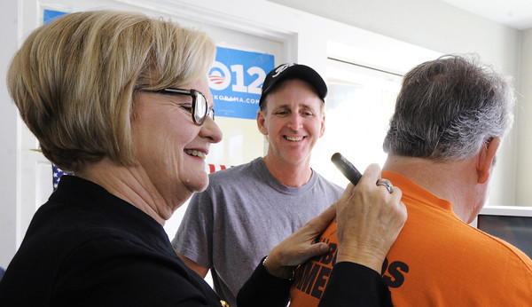 Globe/T. Rob Brown<br /> Sen. Claire McCaskill signs the back of a T-shirt worn by supporter Steve Daniels of Carl Junction during a campaign stopover Thursday afternoon, Nov. 1, 2012, in downtown Joplin.