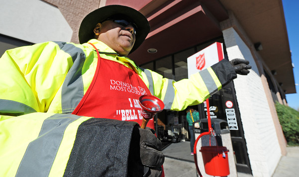 "Globe/T. Rob Brown<br /> Florencio ""Pepper"" Ramirez waves to customers as he rings a bell for the Salvation Army Friday morning, Nov. 23, 2012, outside Price Cutter Plus on Maiden Lane. Ramirez, who is in his second year as a bell ringer, said he will ring the bell for a 10-hour shift Friday and Saturday to kick off the holiday season. ""We can't ring until after Thanksgiving,"" Ramirez said."