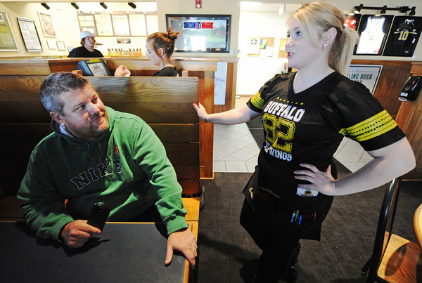 Globe/T. Rob Brown<br /> Chris Belk, of rural Joplin, orders a beverage from Buffalo Wild Wings server Ashley Stephens Tuesday afternoon, Nov. 6, 2012.