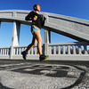 Globe/T. Rob Brown<br /> Amber Lucian Tyree, of Baxter Springs, Kan., makes her daily run over the historic Route 66 Rainbow Bridge Wednesday afternoon, Nov. 14, 2012, just southwest of Riverton, Kan.