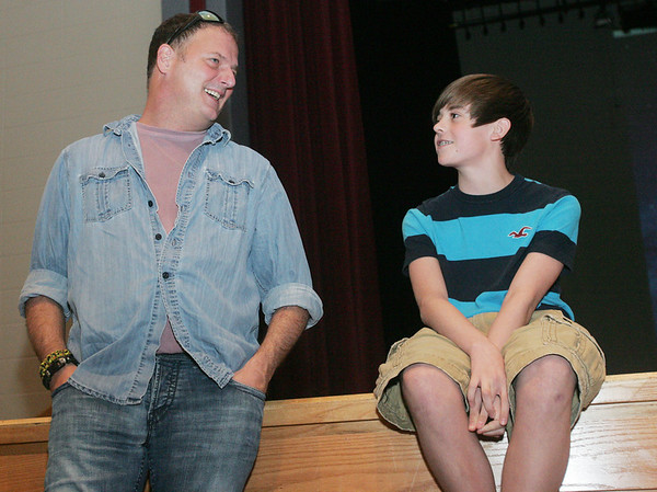 Globe/Roger Nomer<br /> Grant Landis, 13, talks with Brian Maher, a songwriter from Nashville, Tenn., before his video premier at South Middle School.  Maher cowrote songs with Landis for the teen's new album.