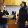 Globe/Roger Nomer<br /> Melinda Roelfs, director for admissions at Pittsburg State, left, and Cathy Lee Arcuino, director of the Pittsburg State Inernational Programs and Services, prepare for an international Thanksgiving meal on Wednesday.