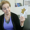 Globe/Roger Nomer<br /> Marion Blumenthal Lazan holds a Star of David used to identify her as a Jew in Germany during the Holocaust.