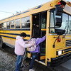 Transportation para-professional Joyce Bole (center) helps 7th-grade student Hannah Workman, with special needs, get on a school bus as bus driver Mike Meyer (background) closes the wheelchair-accessible door in McCune, Kan., recently for the Cherokee County School District, USD 247.<br /> Globe | T. Rob Brown