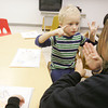 Globe/Roger Nomer<br /> Kristi Wood, a lead teacher at Cerebral Palsy of Tri-County, signs with Evan Hoth, 3, on Wednesday afternoon.