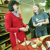 Globe/Roger Nomer<br /> Samantha Bogle, a Pittsburg State senior from Carthage and president of Enactus, helps her mother and early customer Jenny Bogle during the grand opening on Thursday.