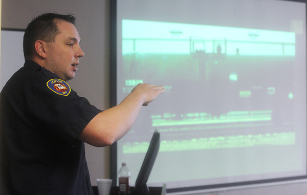 Globe/Roger Nomer<br /> John Miles, a driver/engineer with the Joplin Fire Department, instructs Joplin traffic officers on hazmat safety during an exercise at the Joplin Public Safety Center on Tuesday.