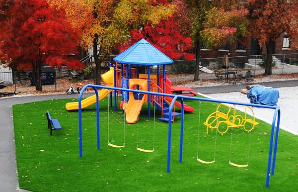 The playground with artificial turf at the Carthage Crisis Center Monday, Nov. 11, 2014.<br /> Globe | T. Rob Brown
