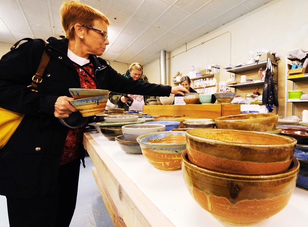 Maria Barr of Joplin (left) selects a few Empty Bowls Thursday afternoon, Nov. 21, 2013, during the charity event at Phoenix Fired Art on South Main Street, Joplin.<br /> Globe | T. Rob Brown