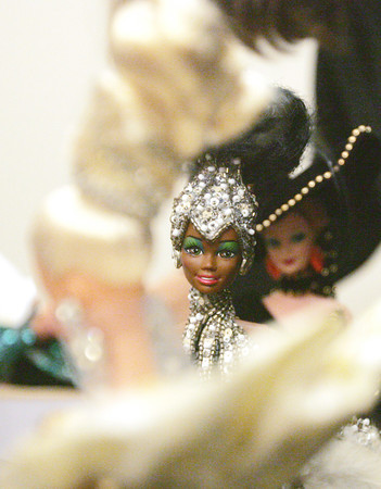 Globe/Roger Nomer<br /> Toni LoPresti's collection of Barbie Dolls includes this Bob Mackie designed Starlight Splendor Barbie.