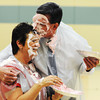 Carl Junction Chamber of Commerce Executive Director Gary Stubblefield (right) hugs Carl Junction Postmaster Sharon Clark after they both threw pies in each other's faces Wednesday morning, Nov. 6, 2013, at the Carl Junction Community Center gymnasium. The event was in recognition of the Carl Junction post office selling the most breast cancer awareness stamps in the nation.<br /> Globe | T. Rob Brown