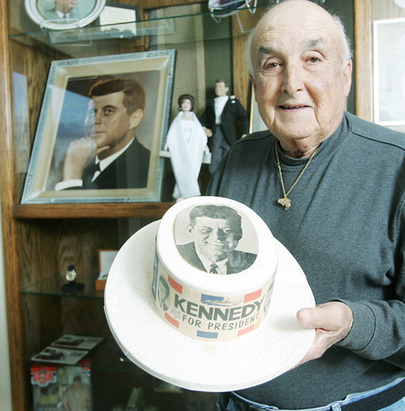 Globe/Roger Nomer<br /> Louis Nicoletti holds a JFK hat from a campaign stop at the Joplin airport in 1962 from his collection.