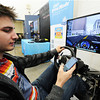 """Freshman Paul Moore, education major, tries texting while driving on a simulator Monday afternoon, Nov. 18, 2013, at Crowder College on the Webb City campus. The simulation to show students the decreased reaction time of texting-while-driving was sponsored by AT&T in coordination with the """"It Can Wait"""" campaign. <a href=""""http://itcanwait.com"""">http://itcanwait.com</a><br /> Globe   T. Rob Brown"""