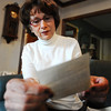 Nancy Harrison reads one of about 150 handwritten letters her father wrote to her mother during World War II.<br /> Globe | T. Rob Brown