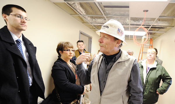 Greg Keller (center), supervisor with RE Smith Construction Co., talks about work being done at the new Joplin Fire Station location during Wednesday morning's Economic Growth Tour, Nov. 13, 2013, on South Main Street/Hearnes Boulevard in Joplin.<br /> Globe | T. Rob Brown