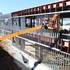 James Stanford of Springfield works from a lift as fellow carpenter Chuck Silverest of Ozark assists him in installing metal studs Thursday afternoon, Nov. 7, 2013, during construction of the new Joplin High School. The two work for PCI (Performance Contracting Inc.) interior division.<br /> Globe | T. Rob Brown