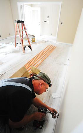 Electrician John Moore with Bill's Electric, a subcontractor for American Construction, installs an electrical outlet Tuesday morning, Nov. 5, 2013, at the future Loving Grace House, 1414 Euclid, in Joplin.<br /> Globe | T. Rob Brown
