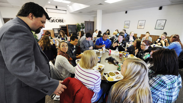 The Joplin Globe Features Editor Joe Hadsall speaks to Journalism Workshop students as they eat lunch Thursday morning, Nov. 14, 2013, in Parkview at The Joplin Globe. Hadsall taught area high school students about editorial writing.<br /> Globe | T. Rob Brown