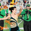 MSSU baton twirler Victoria Bass, a sophomore nursing major, performs using fire batons with MSSU's Lion Pride Marching Band Saturday, Nov. 9, 2013, during the halftime show of the football game at Fred G. Hughes Stadium.<br /> Globe | T. Rob Brown