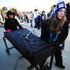 Southmoore (Okla.) High School students junior Katie Loman (right) and freshman Josselyn De La Cruz move one of the school's vibraphones into Junge Stadium Wednesday morning, Nov. 13, 2013, in Joplin.