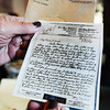 Nancy Harrison looks through one of of about 150 handwritten letters her father wrote to her mother during World War II.<br /> Globe | T. Rob Brown