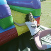 Globe/Roger Nomer<br /> Tara Sanders, a Missouri Southern junior from Joplin, exits a slide after running an obstacle course at the University on Wednesday.  The MSSU Campus Activities Board sponsored the obstacle course for Veterans Week.