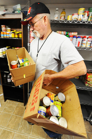 Ted Londo, pantry manager, carries out boxes of canned goods for clients Friday, Nov. 8, 2013, at Soul's Harbor in Joplin.<br /> Globe | T. Rob Brown