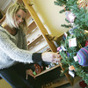 Globe/Roger Nomer<br /> Anna Gudde, events director with the Pittsburg Chamber of Commerce, looks at Christmas decorations at Krimson Kultuur during the grand opening on Thursday.